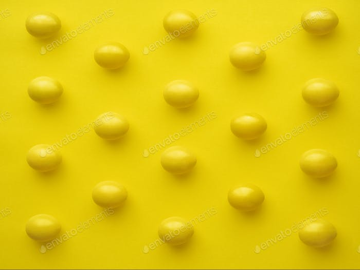 Pattern Of Chicken Eggs In Line Against Yellow Background