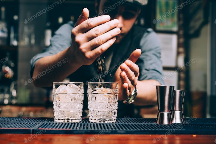 Portrait of vintage barman making cocktails and working at pub or bar