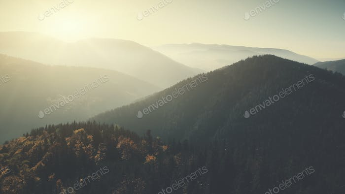 Panoramic mountain peak forest slope aerial view