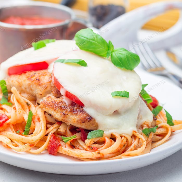 Chicken caprese with tomato and mozzarella cheese, served with l