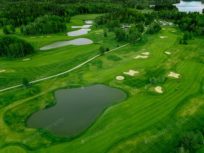 Aerial view of green grass at golf course in Finland