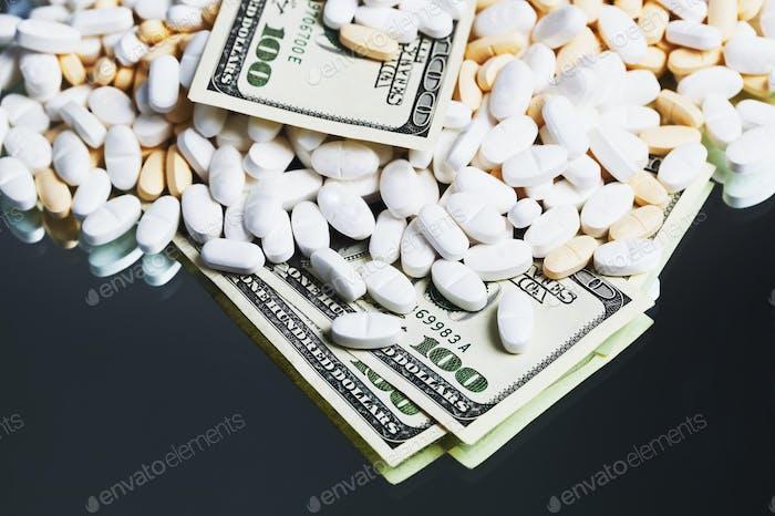 54793,Prescription medication and one hundred dollar bills