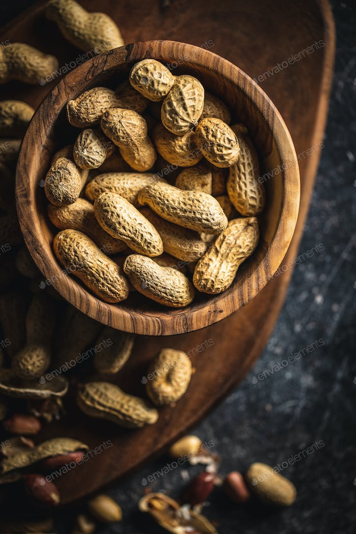 Roasted peanuts. Tasty groundnuts in bowl.