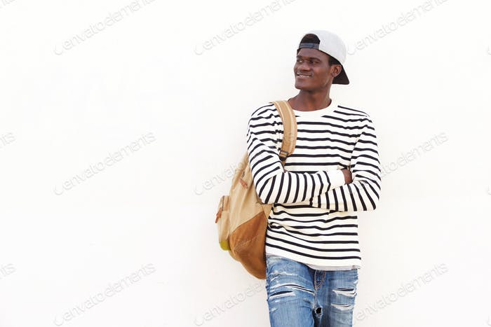 handsome young African American student leaning against wall