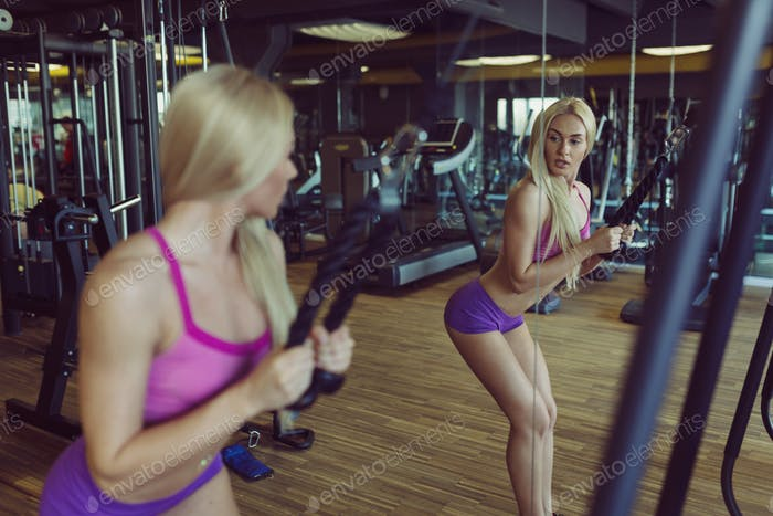 Strong and beautiful athletic woman training in the gym
