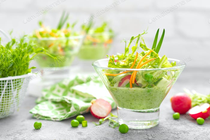 Fresh vegan vegetable salad with carrot, lettuce, green peas, radish, sprouts and cucumber smoothie