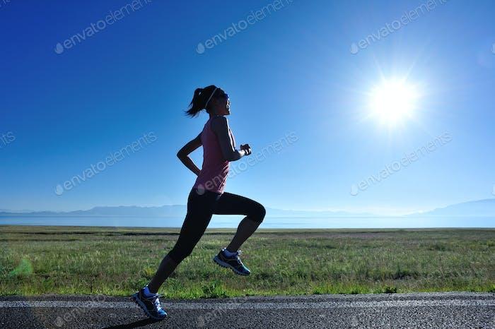 Running in sunrise mountain trail