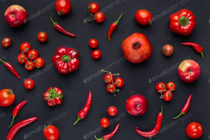 Food pattern constructed with red fruits and vegetables