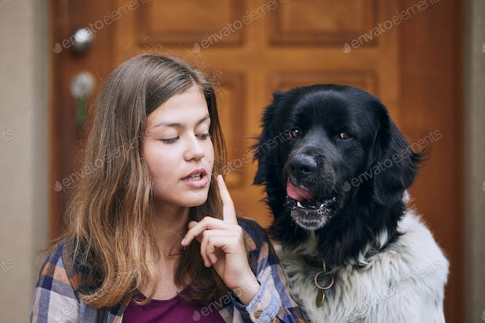 Funny portrait of teenager girl with her dog