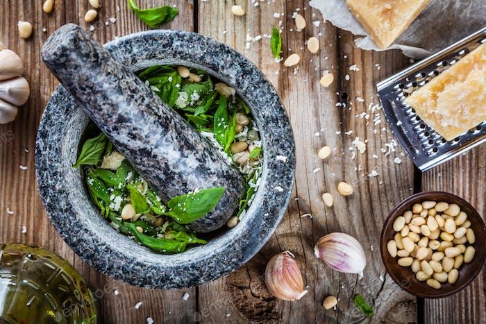 ingredients for pesto: basil, parmesan, pine nuts, garlic, olive oil