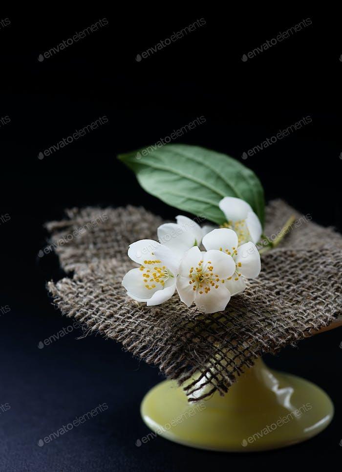 Jasmine flowers on cake stand
