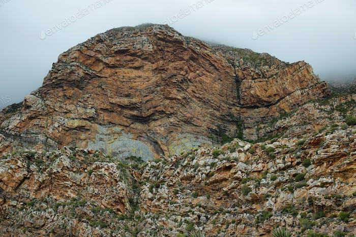 Majestic rocky redish mountains in Seweweekspoort pass