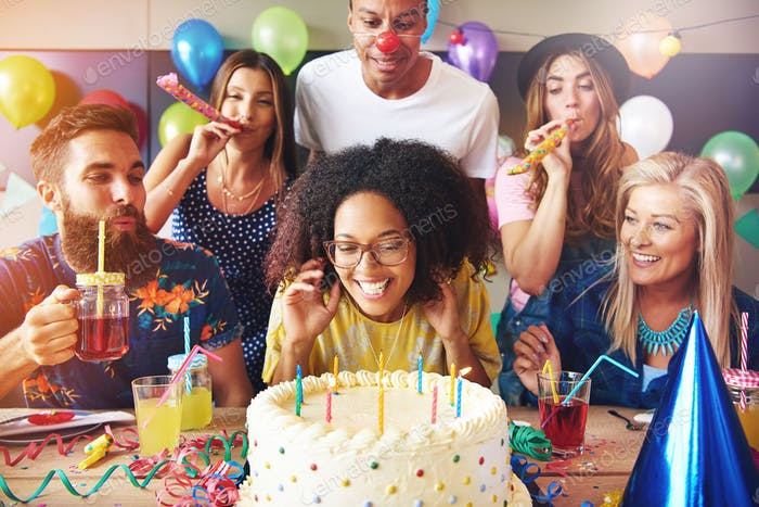 Excited woman ready to blow out candles