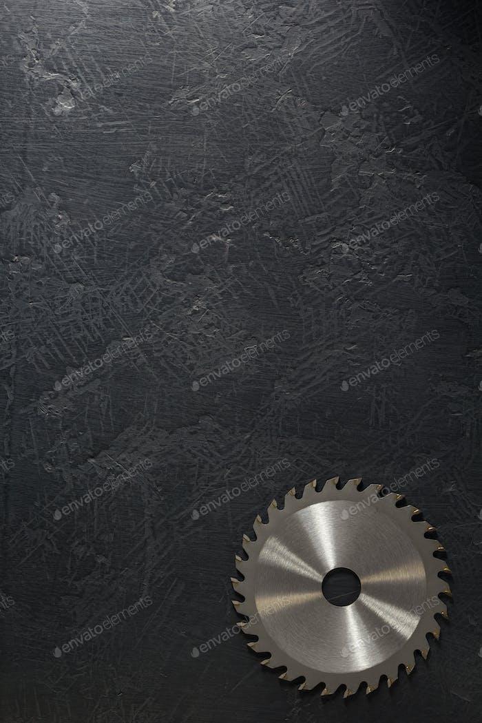 circular saw blade at black background