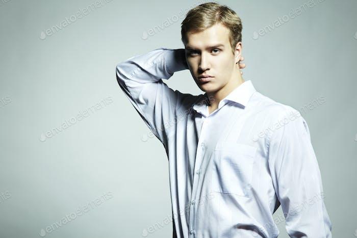 Fashion portrait of young beautiful man