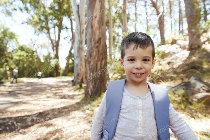 Portrait Of Boy Wearing Backpack On Countryside Walk