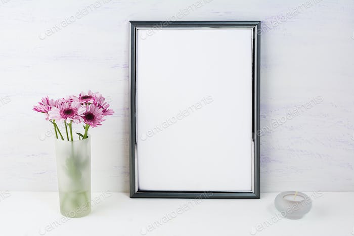 Frame mockup with lilac daisies