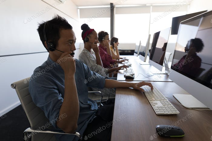 Executives talking on headset in modern office
