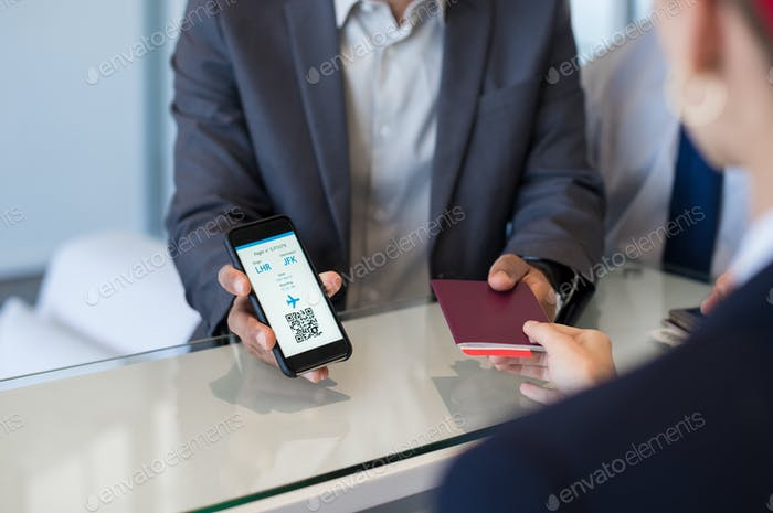 Man showing electronic flight ticket