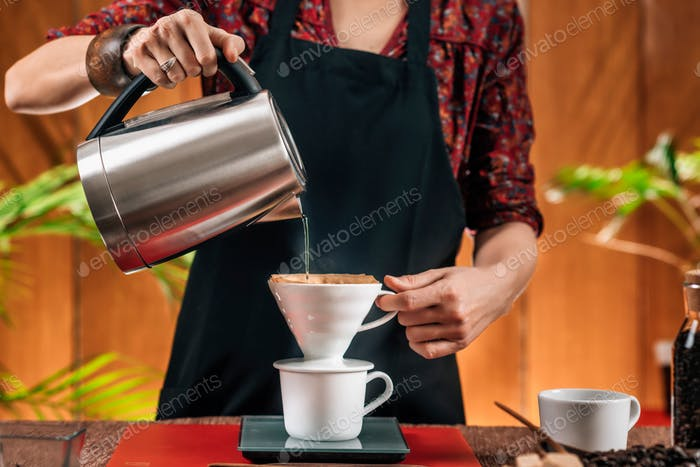Drip Coffee Making. Barista Pouring Boiling Water From Kettle in