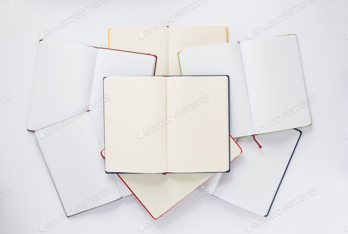 open notebook or book with empty pages on white  background