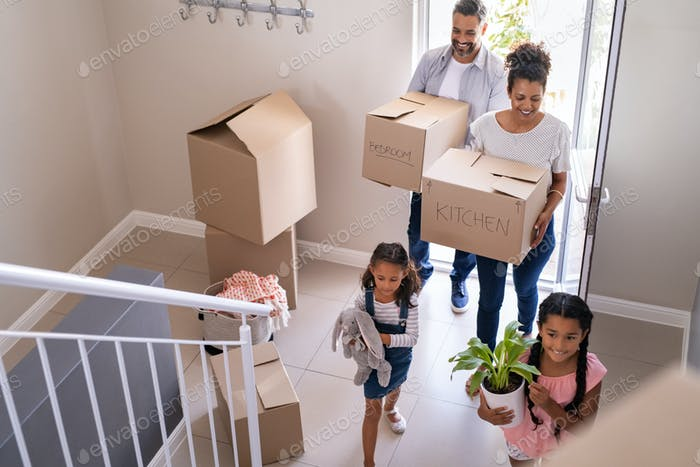 Multiethnic family moving in new home