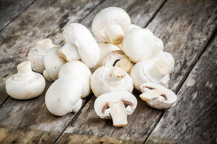 raw fresh mushrooms on a wooden table