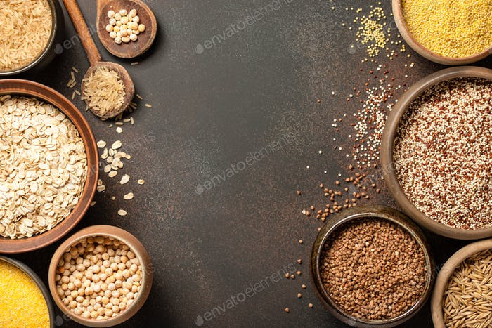 Set with various cereal grains on metallic surface