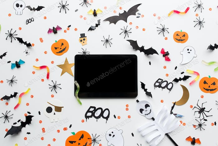tablet pc, halloween party decorations and candies