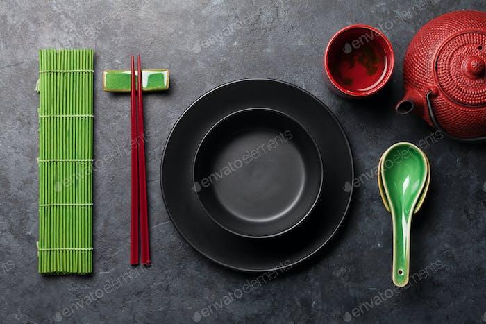 Japanese tea, empty plate and chopsticks
