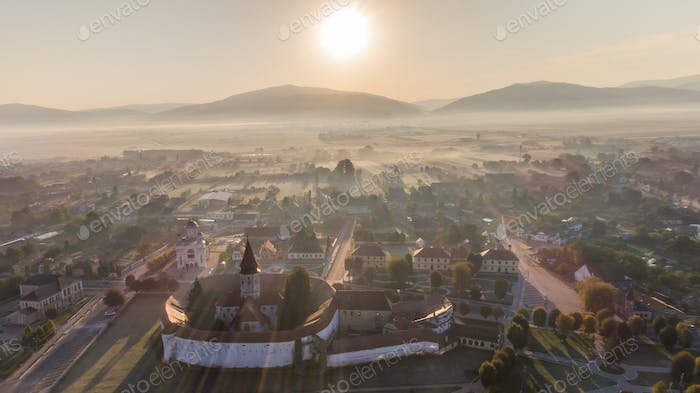 sunrise in Prejmer village. Brasov, Romania