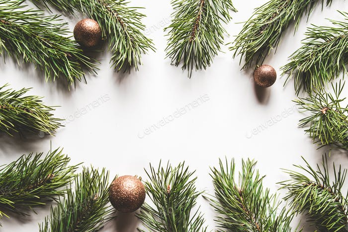 Christmas or New Year decoration background: sweet Christmas canes and branches of a Christmas tree