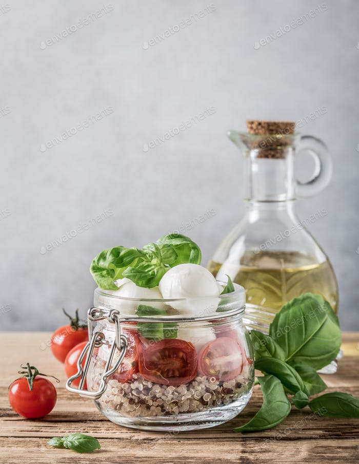 Caprese salad in glass jar.