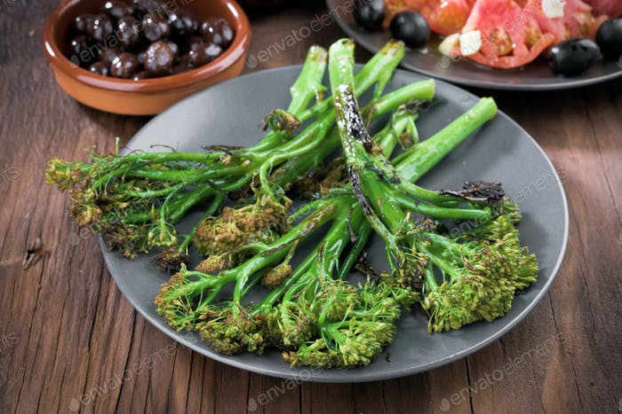 Roasted broccoli on rustic wooden board