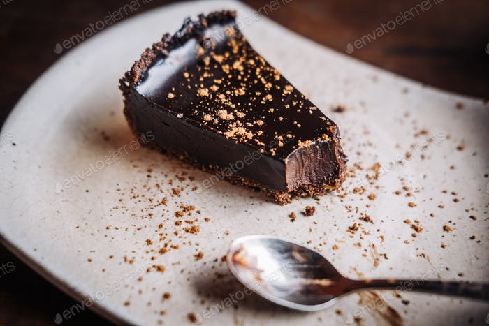 Slice of raw vegan dark chocolate cake