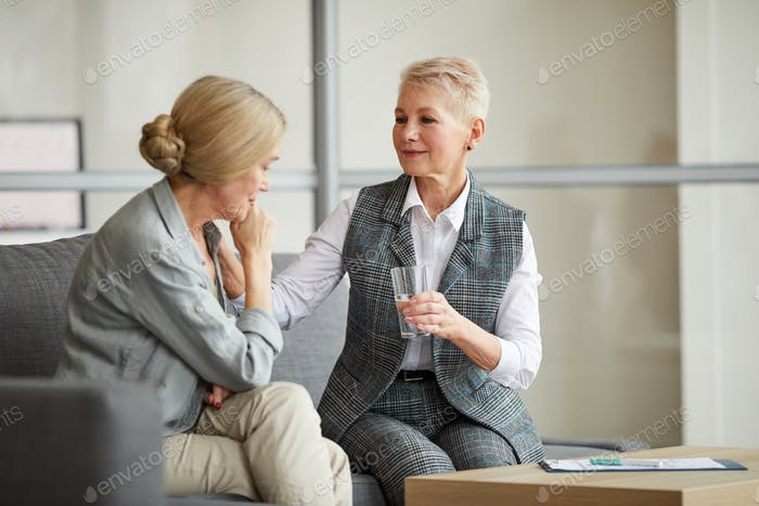 Female Psychologist Consulting Mature Woman
