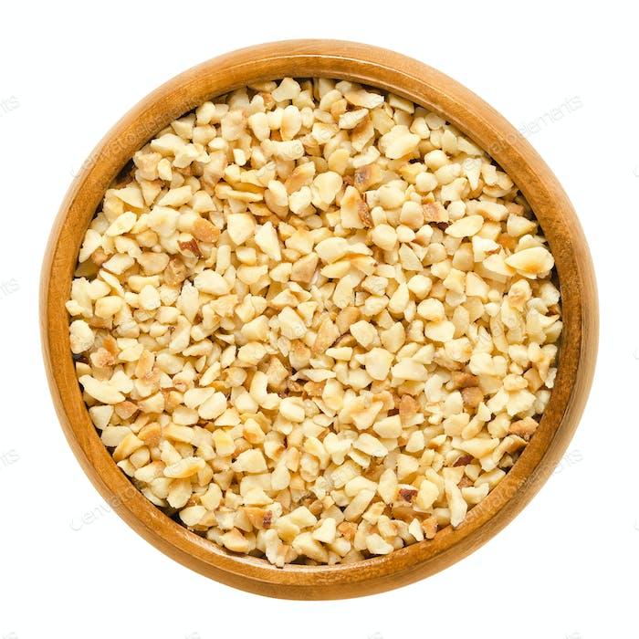 Hazelnut kernels, roughly chopped, in wooden bowl
