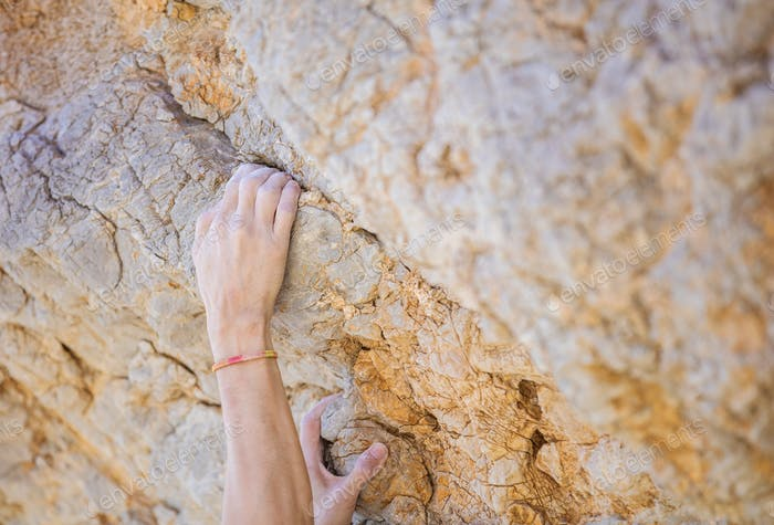 Climber's hands on cliff