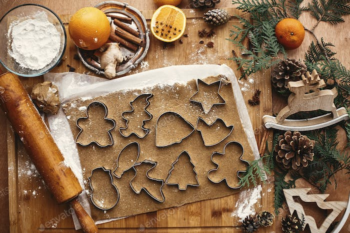 Gingerbread dough with metal cutters in different shapes for christmas cookies