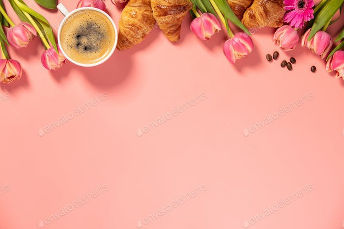 Morning coffee, croissants and a beautiful flowers. Cozy breakfast.