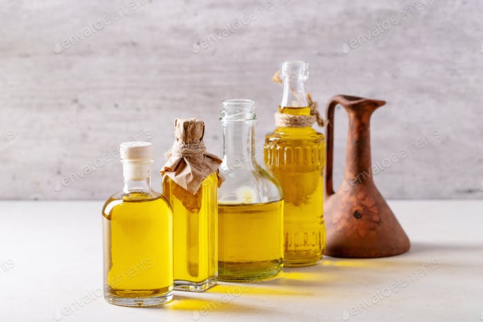 Olive oil in glass bottles