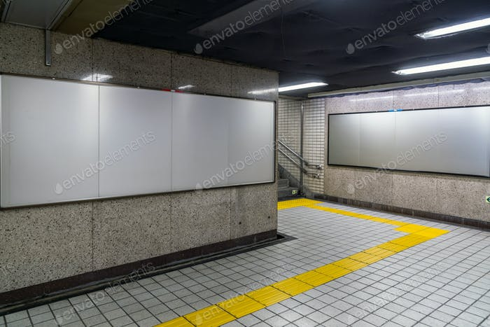 Blank billboard located in underground hall or subway for advertising, mockup concept