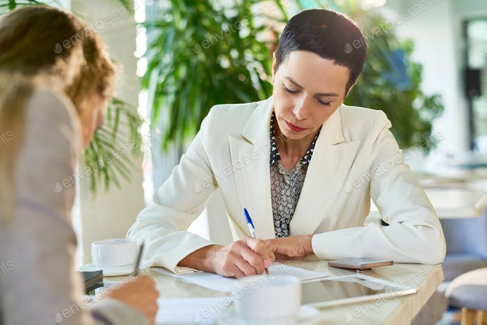 Female Business Leader Signing Papers
