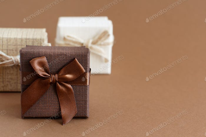 Brown tones gift boxes on a brown background
