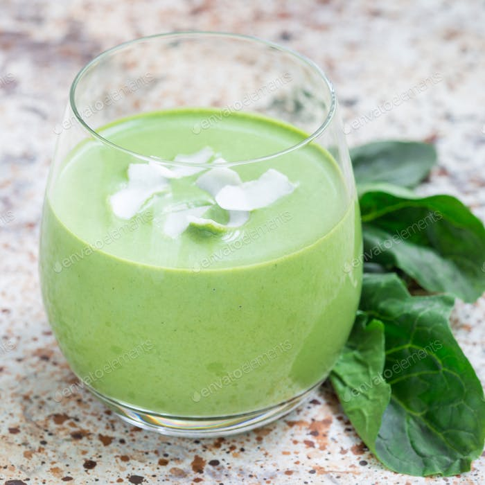 Vanilla, mint, spinach and coconut milk detox green smoothie in a glass, square format