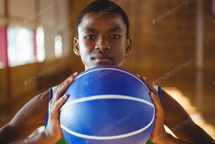 Close up portrait of serious man with basketball