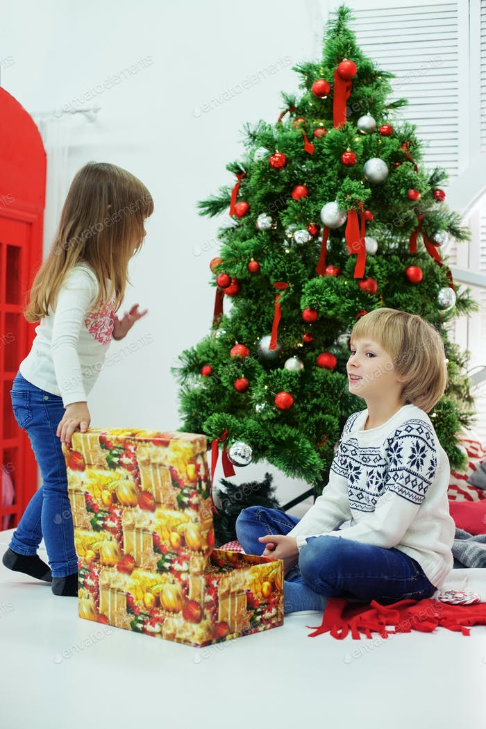 little brother and sister received gifts. The concept of Christm