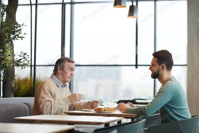 Two men having breakfast