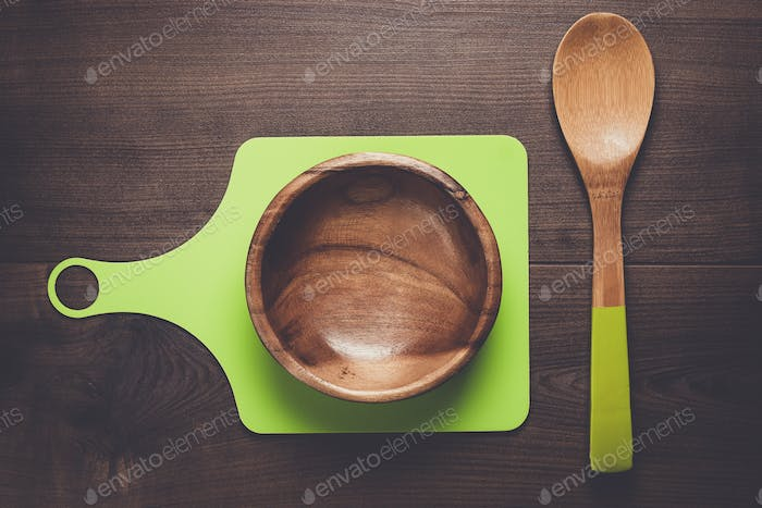 empty salad bowl and two spoons