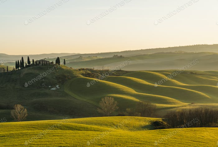 Dramatic Sunrise at Tuscan farmlands. The photograph was taken in Val d'Orcia countryside
